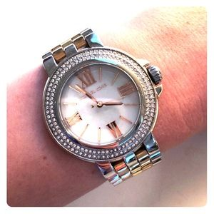 Silver and gold metal Michael Kors watch.